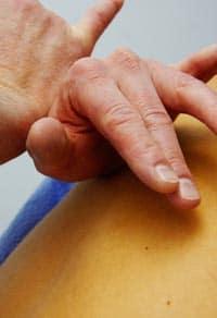 Pair of hands performing chiropractic