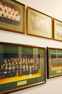 Student photos on a wall